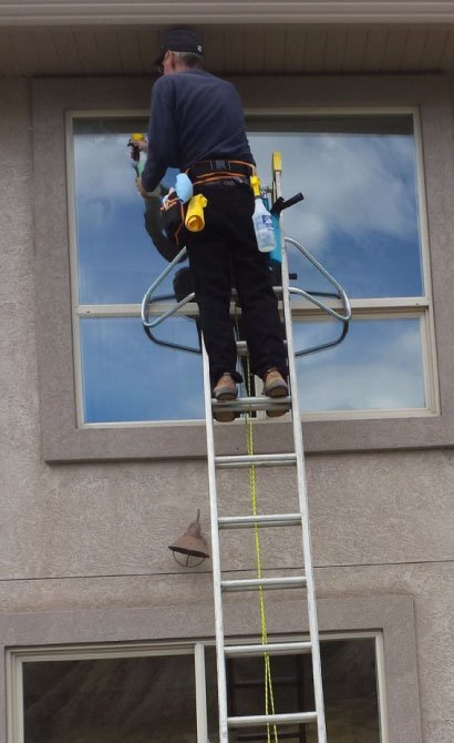 window-cleaner-using-ladder-for-window-cleaning