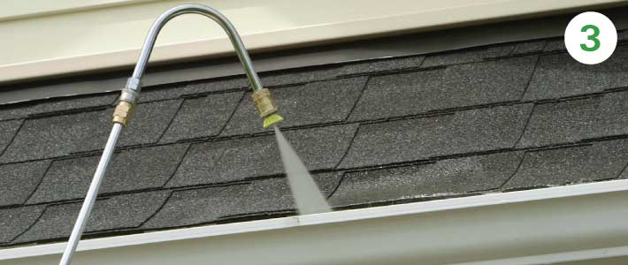 2 story house gutter-cleaning-with-Pressure-Power-Washer